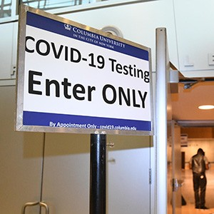 Sign in Lerner Hall reads: COVID-19 Testing, Enter Only, By Appointment Only, covid19.columbia.edu