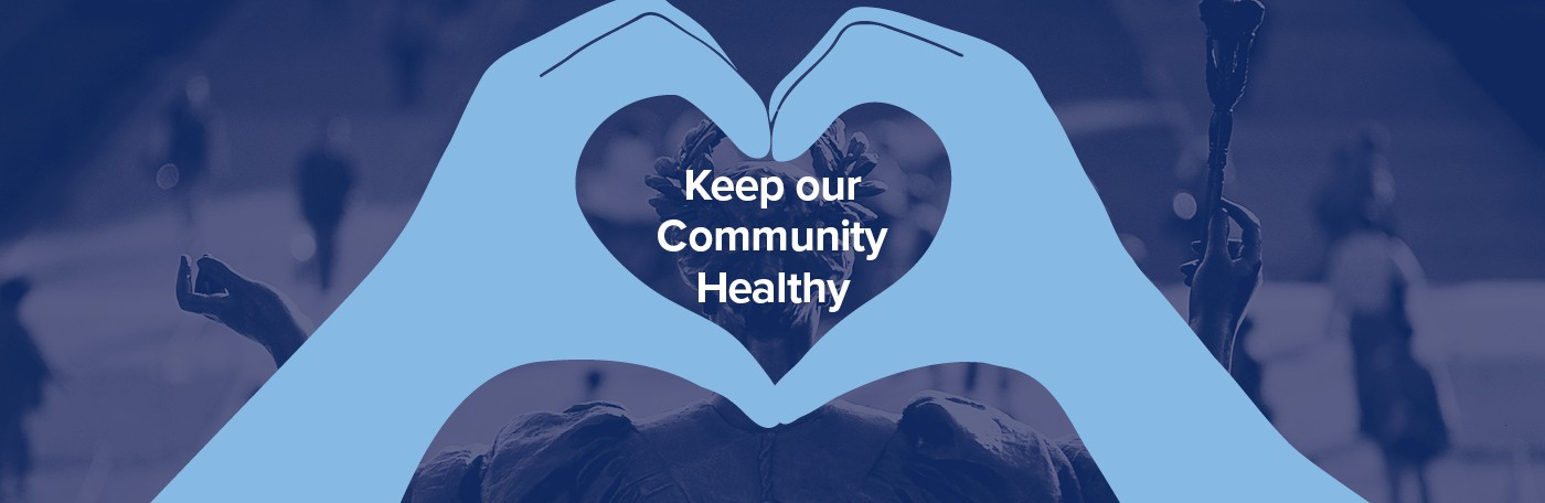 Keep our community healthy in white text on a dark blue background, inside a pair of hands shaping a heart