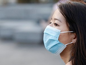Profile image of a woman wearing a face mask